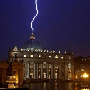 ominous photos of lightening strikes over St. Peter's yesterday are going viral